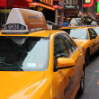 Stock Photo: Row of yellow taxi cabs