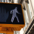 Green pedestrian signal - Stock Photo