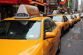 Row of yellow taxi cabs — Stock Photo
