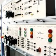 Control panels in an electronics lab - Stock Photo