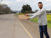 Hitchhiker on the road — Stock Photo