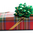 Gift box of red color with a green bow — Stock Photo