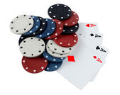 Cards and counters for poker on a white background — Stock Photo