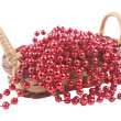 New Year's beads in a wattled bast basket - Stock Photo