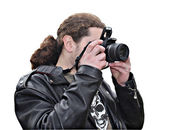The person in a black jacket with long hair photographs — Stock Photo