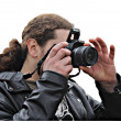 The person in a black jacket with long hair photographs — Stok fotoğraf