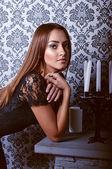 Beauty girl on gothic backround — Stock Photo
