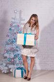 Beaty girl with present — Stock Photo