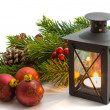 Christmas tree and burning lantern — Stock Photo