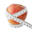 Apple and measurement tape — Stock Photo