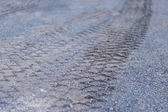 Tracks on road — Stock Photo