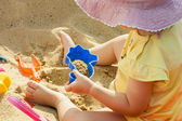 Little girl and sand toys — Stock Photo