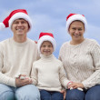 Happy family in Christmas hats — Stock Photo #13535071