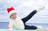 Portrait of a smiling girl in a Christmas skating — Stock Photo