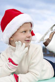 Portrait of a smiling girl in a Christmas hat — Stock Photo