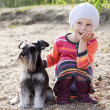 Little girl and her dog — Stock Photo