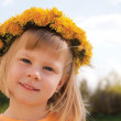 Girl with flower wreath — Stock Photo