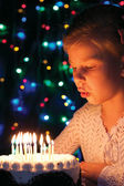 Girl blows out the candles on the cake — Stock Photo
