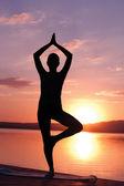 Meditating at sunrise — Stock Photo