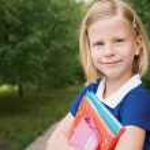 Portrait of cute schoolgirl — Stock Photo #28114485