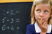 School Girl thinking on the task — Stock Photo