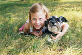 Girl and a dog — Stock Photo