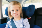 Girl in the car seat — Stock Photo