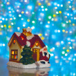 Christmas house on a background of blurred lights — Stock Photo