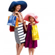 Two attractive happy girls out shopping — Stok fotoğraf