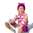 Child leaning ice skating — Stock Photo