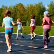 Group of children running around stadium in summer — Stock Photo #39760681