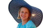 Beautiful girl in a blue hat on a summer day — Stock Photo