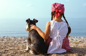 Beautiful girls embracing her dog — Stock Photo