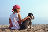 Beautiful little girls with her dog — Stock Photo