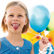 Foto Stock: Girl licking ice cream