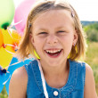 Foto Stock: Girl with balloons