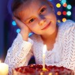 Cute little girl looking at cake — Stock Photo #42274719