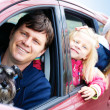 Family with a dog in the car — Stock Photo #44145433
