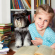 Girl and dog reading books — Stock Photo