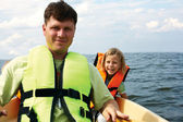 Little girl and her father on a kayak at summer — Stock Photo