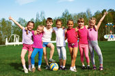 Portrait of seven little children with balls — Stock Photo