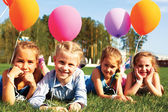 Group of happy children with balloons — Stock Photo