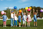 Big group of happy children with balloons — Stock Photo