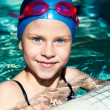 Portrait of a kid laughing in a swimming pool. — Stock Photo #47342789