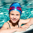 Portrait of a kid laughing in a swimming pool. — Stock Photo #47342793