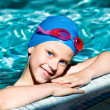 Portrait of a kid laughing in a swimming pool. — Stock Photo #47408641