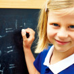 Schoolgirl decides on a blackboard mathematical tasks — Stock Photo #47732211