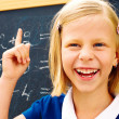 schoolgirl found the correct solution of a mathematical problem — Stock Photo #47732217