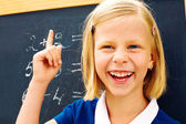 schoolgirl found the correct solution of a mathematical problem — Stock Photo