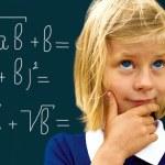 Schoolgirl ponders solving a mathematical problem — Stock Photo #47747275